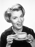 1960s Woman Drinking Coffee Holding Cup and Saucer Photographic Print