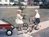 1950s Little Girl Sister Holding Doll Watching Little Boy Brother Repair Tricycle Photographic Print