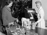 1950s Woman at Grocery Store Checkout Counter Handing Items over to Cashier Photographic Print