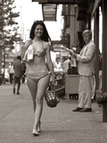 1970s Man Ogling Sexy Young Woman Walking Down City Street Wearing Only a Bikini Photographic Print