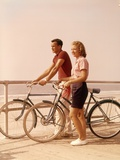 1950s-1960s Teen Couple Standing by Bikes on Beach Boardwalk Fotoprint