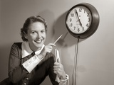 1950s Woman Holding Steno Pad Pointing with Pencil to Clock 5 Minutes Till Quitting Time Photographic Print