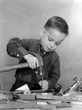 1950s Boy Playing with Hammer and Tools Photographic Print