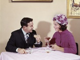 1960s Couple Drinking Cocktails at Table Husband Wife Indoor Photographic Print