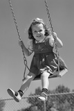 1940s Girl Swinging on Playground Swing Photographic Print
