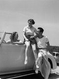 1930s Friends Sitting with Convertible Roadster Automobile Talking Together at Seashore Photographic Print