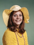 1970s Smiling Young Woman Wearing Yellow Floppy Brim Hat and Blouse with Pink Beads Photographic Print