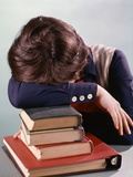 1960s-1970s Female Student Head Down on Pile of Books Asleep Exhausted Photographic Print