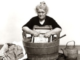 1930s-1940s Senior Woman Washing Clothes in Old Fashioned Wooden Tub and Washboard Photographic Print