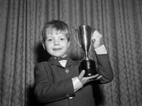 1950s Proud Boy Holding Up Trophy Award Photographic Print