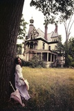 1960s-1970s Woman Standing Beside Tree Front of Abandoned Haunted Victorian House Photographic Print