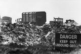 Warning Sign at Garbage Dump Photographic Print