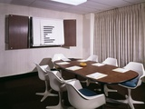 1960s Office Conference Room with Table Chairs Writing Pads Ashtray and Wall Chart Photographic Print