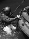 1930s Side View of Diver in Pressure Suit Descending into Water from Side of Boat Photographic Print