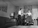 1950s Teen Couple Doing Jitterbug Rock and Roll Dance in Living Room Man Woman Boy Girl Photographic Print