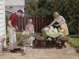 1960s Family Father Mother Two Daughters Barbeque in Backyard on Brick Patio Photographic Print