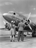 1940s Rear View of Boy and Girl Standing Together Looking at Propeller Airplane Outdoor Photographie