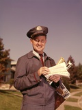 1960s Mailman Holding Letters Mail Leather Mailbag in Suburban Neighborhood Photographic Print