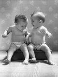 1930s-1940s Twin Babies Wearing Diapers Together Sitting on a Bench Side by Side Studio Photographic Print
