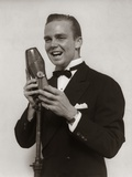 1920s-1930s Man Radio Singer Entertainer Crooner in Tuxedo Singing into Microphone Photographic Print