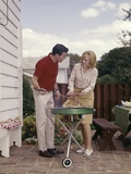 1960s Couple Man Woman Grilling Steak on Backyard Patio Bar-B-Cue Charcoal Grill Photographic Print