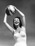 1940s Woman in White Bathing Suit Holding a Beach Ball over Her Head Outdoor Photographic Print