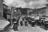 Horse-Drawn Carriages and Storefronts on Mackinac Island Photographic Print