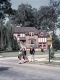 1950s Kids Carry Book Bags Crossing Street by Yellow Stop Sign in Suburban Neighborhood Photographic Print