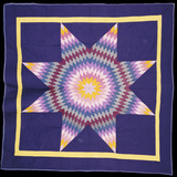 An Amish Pieced and Quilted Cotton Coverlet Worked in a Multicolored Lone Star on a Navy Background Photographic Print