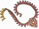 An Indian Ruby and Diamond Necklace with a Centre-Piece Designed as a Double-Peacock Photographic Print