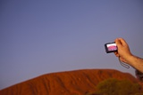 Tourist Photographing Ayers Rock in the Australian Outback Photographic Print by Paul Souders