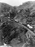 Wagon Train on Mountain Pass Photographic Print