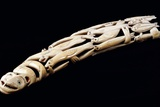An Eskimo Carved Walrus Ivory Tusk with Various Spirit and Animal Figures Photographic Print