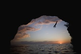 Young Man Diving into Sea at Pirate's Cave Photographic Print by Paul Souders