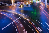 Traffice Moving Through Intersection at Night Photographic Print by Paul Souders