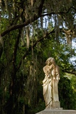 Graveyard Statue and Trees Draped in Spanish Moss at Entrance to Bonaventure Cemetery Photographic Print by Paul Souders