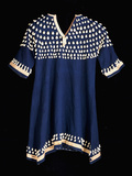 A Hunkpapa Sioux Girl's Dress of Blue Wool Cloth Trimmed with Cowrie Shells Photographic Print