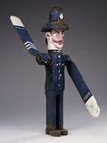 A Polychrome Wood and Metal Whirligig Modelled as a Police Sergeant Photographic Print
