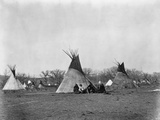 A Native American Family Sits Outside their Teepee Photographic Print by W.S. Soule