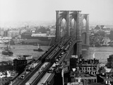 Brooklyn Bridge over East River and Surrounding Area Photographic Print by A. Loeffler