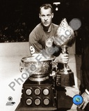 Detroit Red Wings Gordie Howe Posed with the Hart Memorial Trophy and the Art Ross Trophy. Circa 19 Photo
