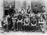 1890S Factory Workers Seated Outside of Building Photographic Print by H. Armstrong Roberts