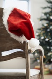 Santa Hat on Chair Photographic Print by Pauline St. Denis