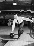 Man Bowling in Tie and Slacks Photographic Print by Philip Gendreau