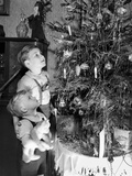 Two Brothers Look at a Christmas Tree in their Living Room in Germany, Ca. 1949 Stampa fotografica