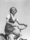 1930s Smiling Blonde Woman Riding Bicycle Photographic Print