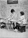 1920s Two Little Girls Playing Ironing Washing Doll Clothes Photographic Print