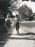 Boy and Girl Walking to School Photographic Print by Philip Gendreau