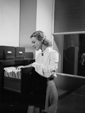 Woman and File Cabinet Photographic Print by Philip Gendreau