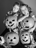 1950s Boy and Girl with Four Jack-O-Lanterns Photographic Print